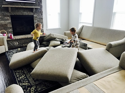 indoor physical activities little kids jumping on couch cushions
