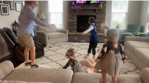indoor physical activities 4 young kids jumping and dancing around a living room