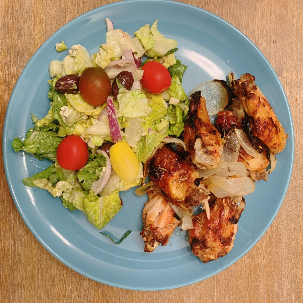 plated chicken wings with salad
