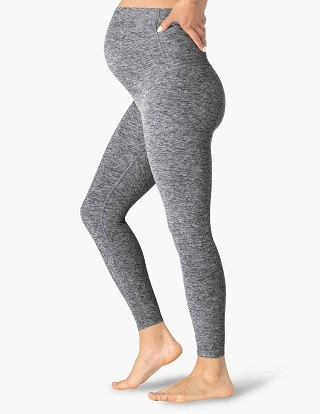 maternity leggings a pregnant woman wearing grey leggings over her belly
