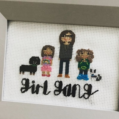 surviving divorce a cross-stitch sign with a woman, 2 girls, and 2 dogs