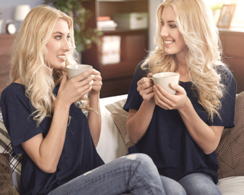 twins are not genetic clones identical twins women drinking coffee in matching clothes