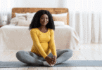 woman on the floor of her bedroom doing Pregnancy Stretches