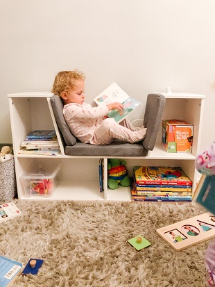 destructive kids a toddler reading a book in a playroom
