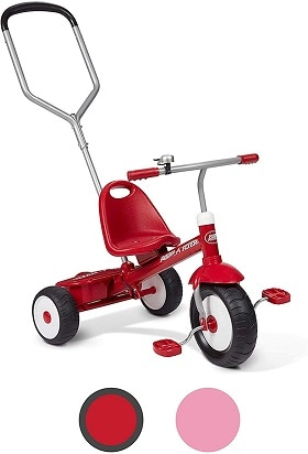A red tricycle with a push handle on the back