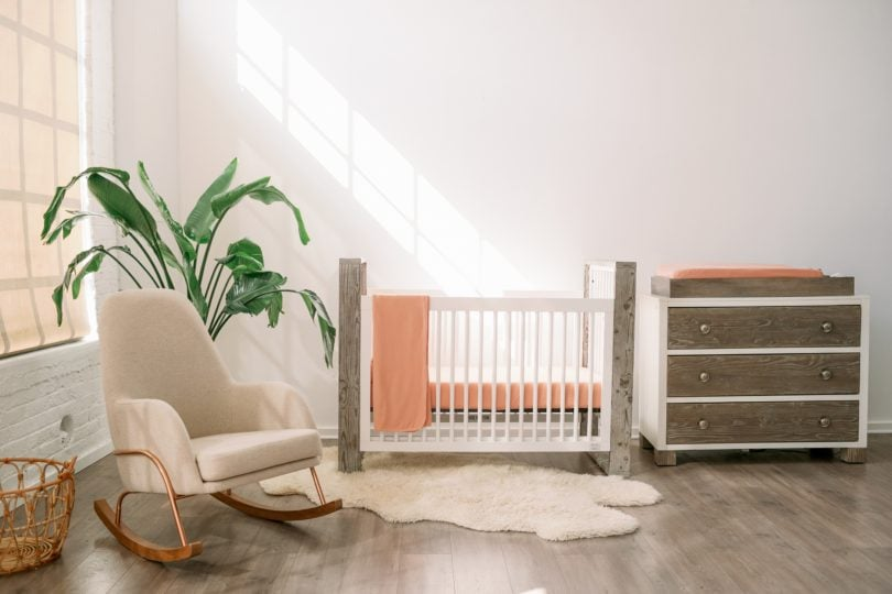 baby's room with crib, dresser, and rocker