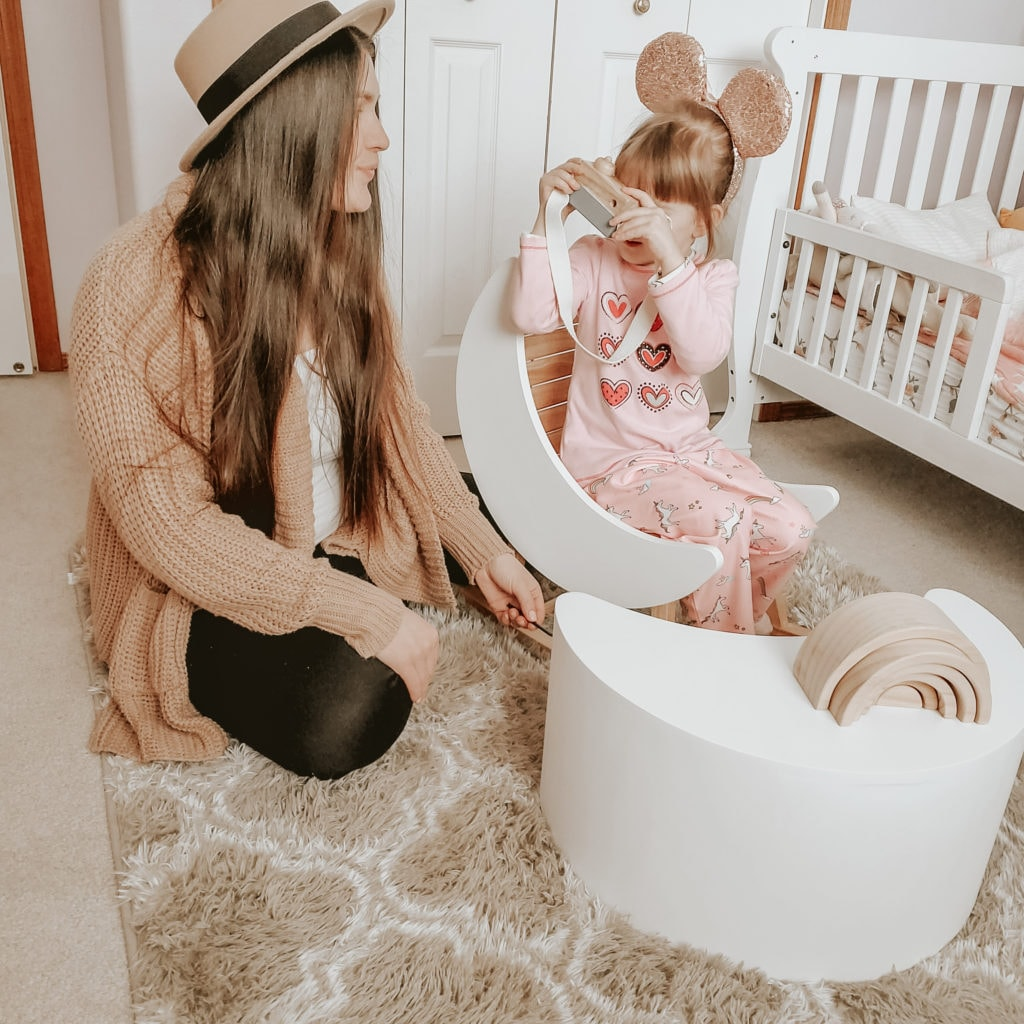 mom with little girl sitting on a child rocking chair