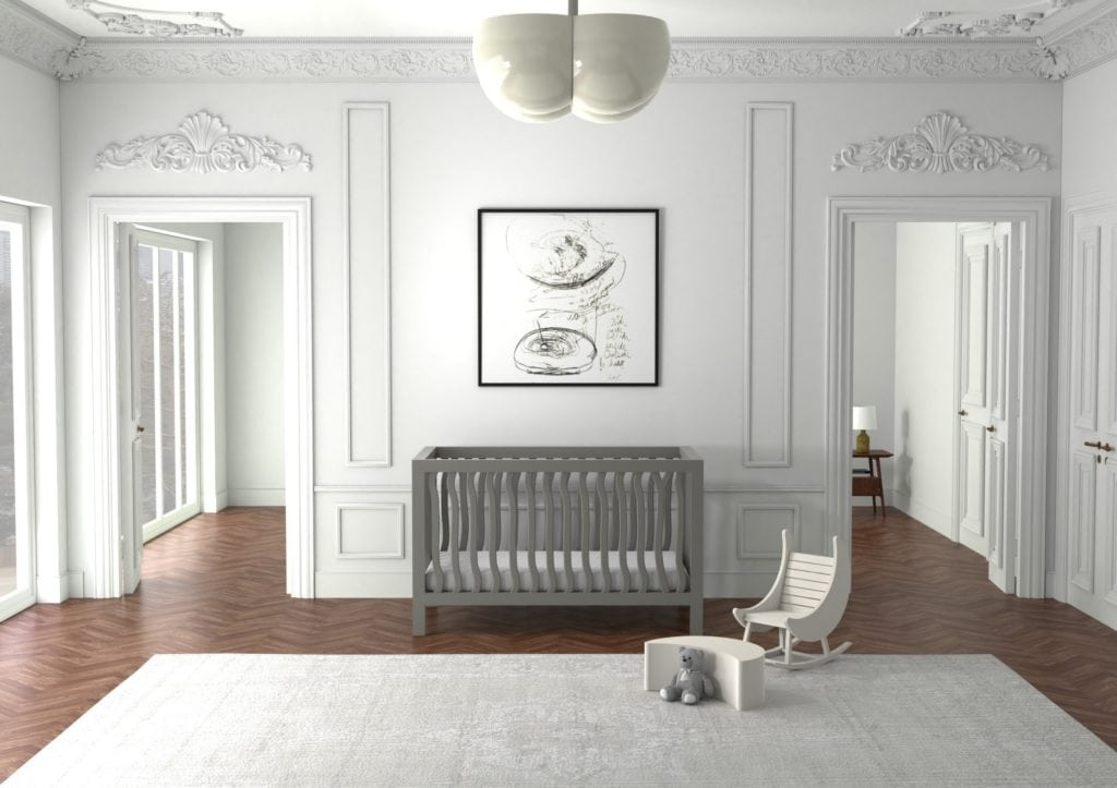 baby's room with a crib, toddler rocking chair, and ottoman