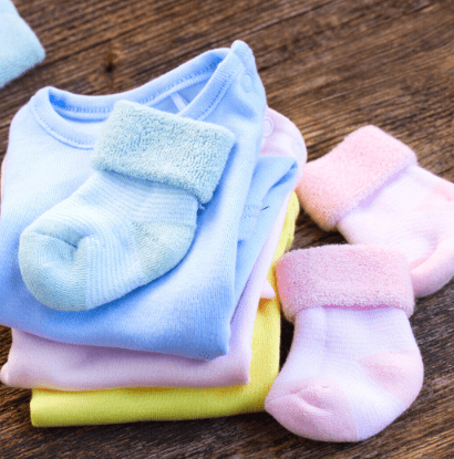 pink baby socks with blue socks and baby onsies