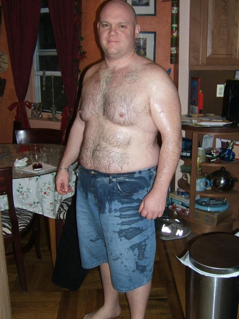 man with no shirt and covered in spit up