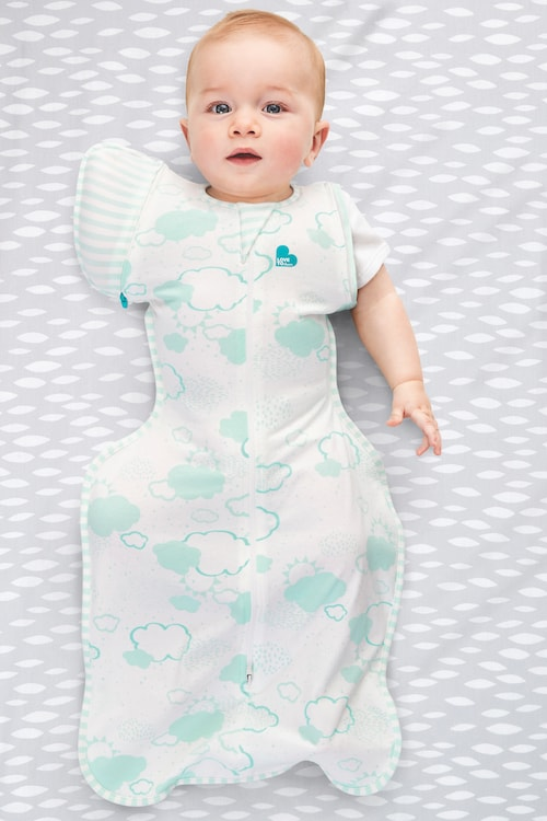 baby wearing a transition swaddle blanket