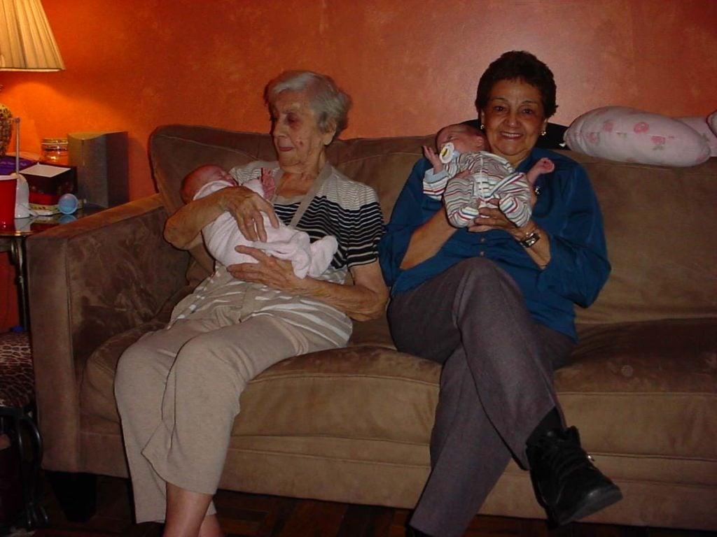 two grandmas holding twins