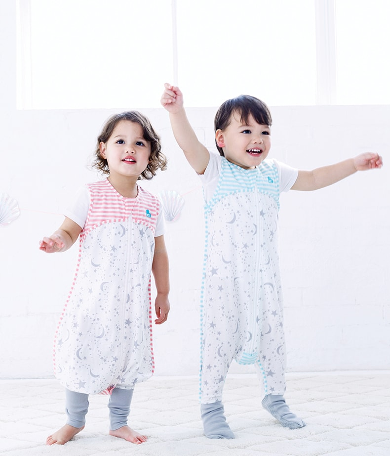 two children wearing sleep suits