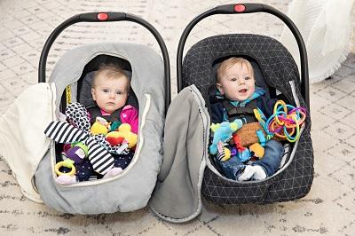 boy girl twins in car seats