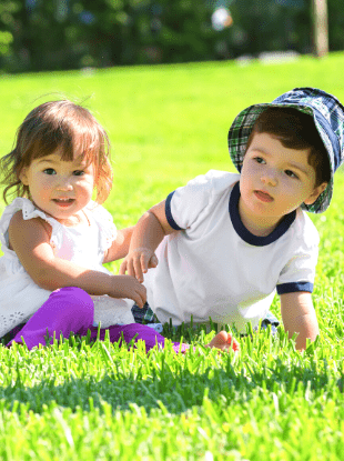 boy girl twins in the grass