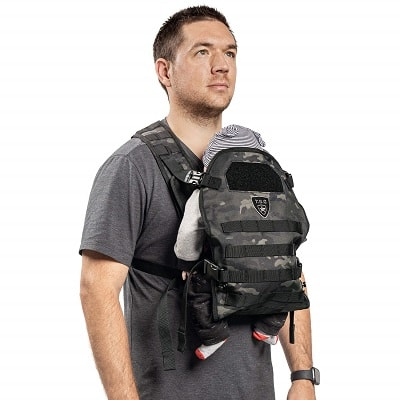 a man using a front baby carrier, hands free