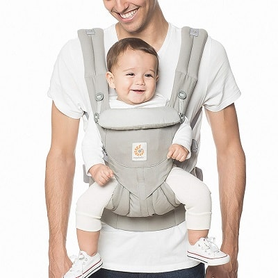a man using a front baby carrier