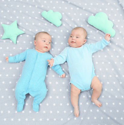 baby twins on a blanket