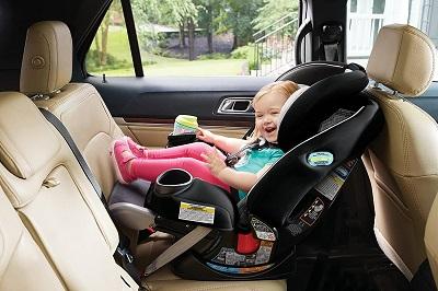 little girl in rear-facing car seat