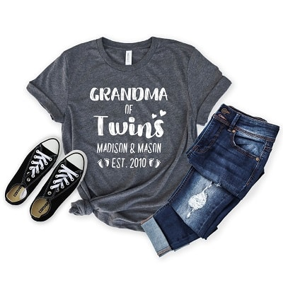 Grey grandma of twins shirt with black shoes and folded jeans