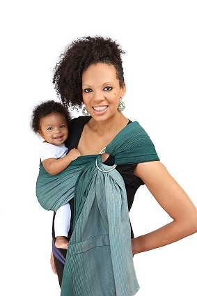 a woman holding a baby in a ring sling carrier, both smiling