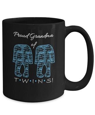 black mug with blue baby clothes