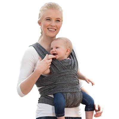 a woman holding an infant in a front facing wrap baby carrier