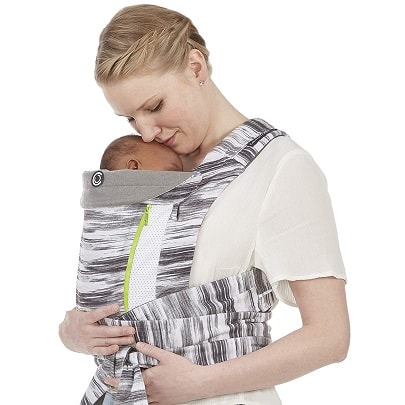 a woman holding a baby close in a front carrier