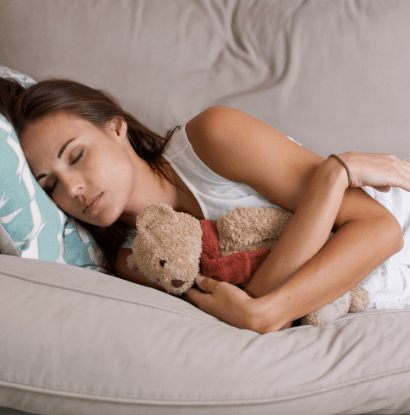 mom taking a nap with a stuffed bear
