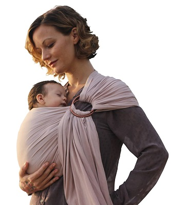 a woman cradling a sleeping newborn in a ring sling carrier