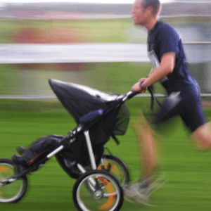 man running with a double jogging stroller