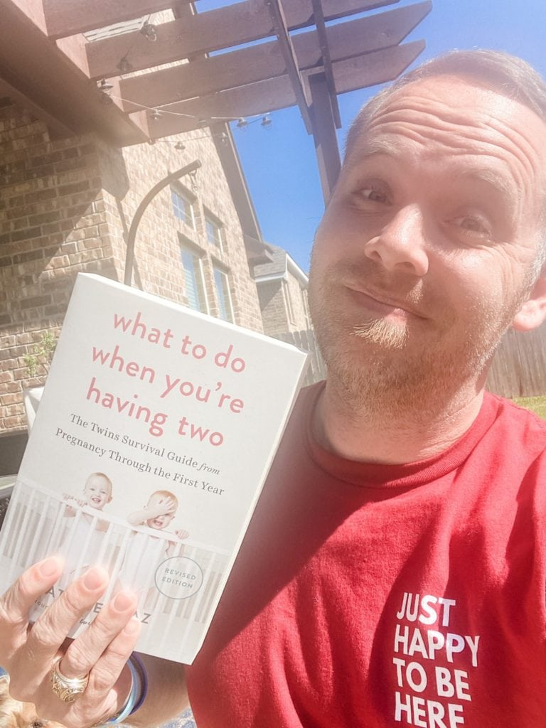 dad holding what to do when you're having two book