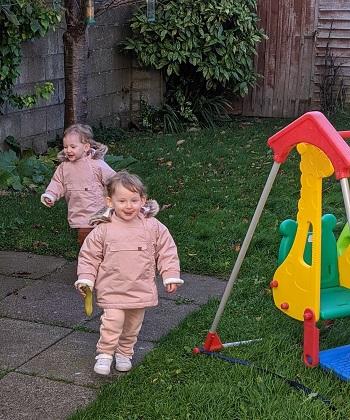 twin girls running outside