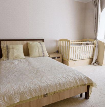 bed with a crib in a corner