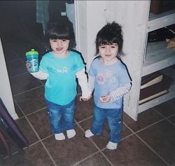 di di identical twin girls holding hands