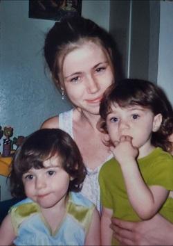 di di identical twin girls on their moms lap