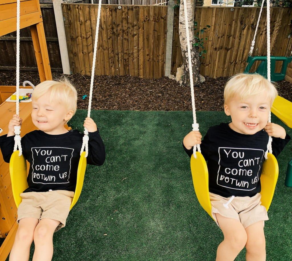 twin boys on swings