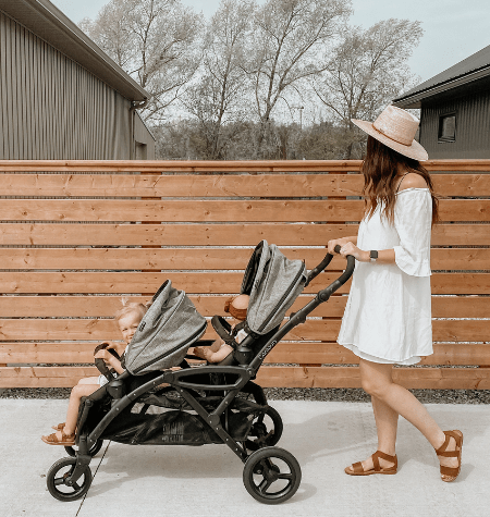 woman pushing twins in double stroller