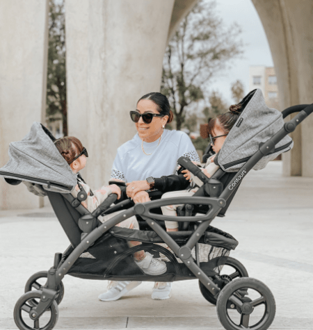 woman with twins in a double stroller