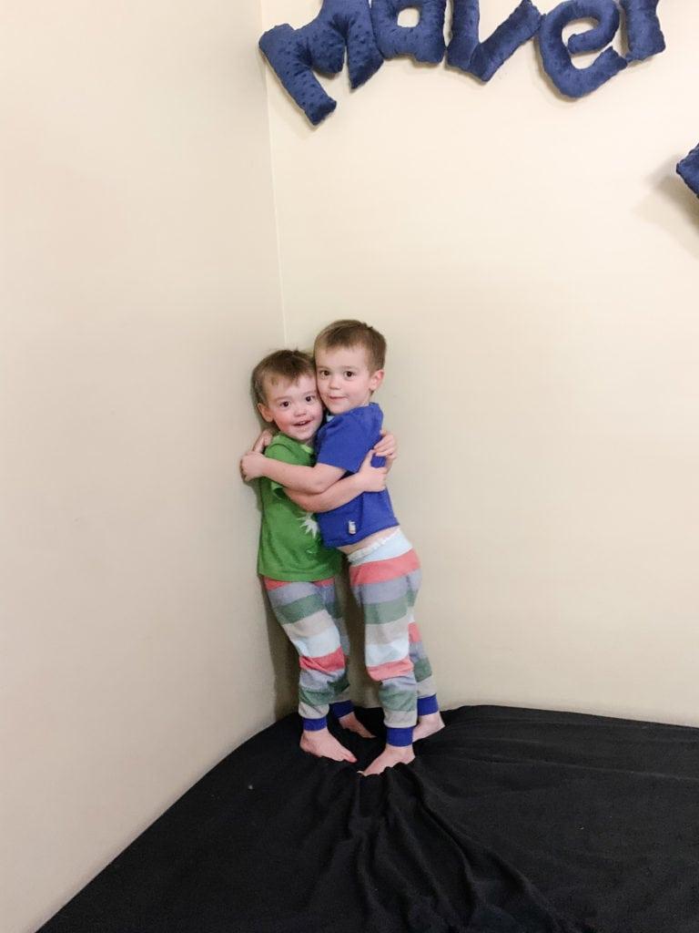 twin boys hugging