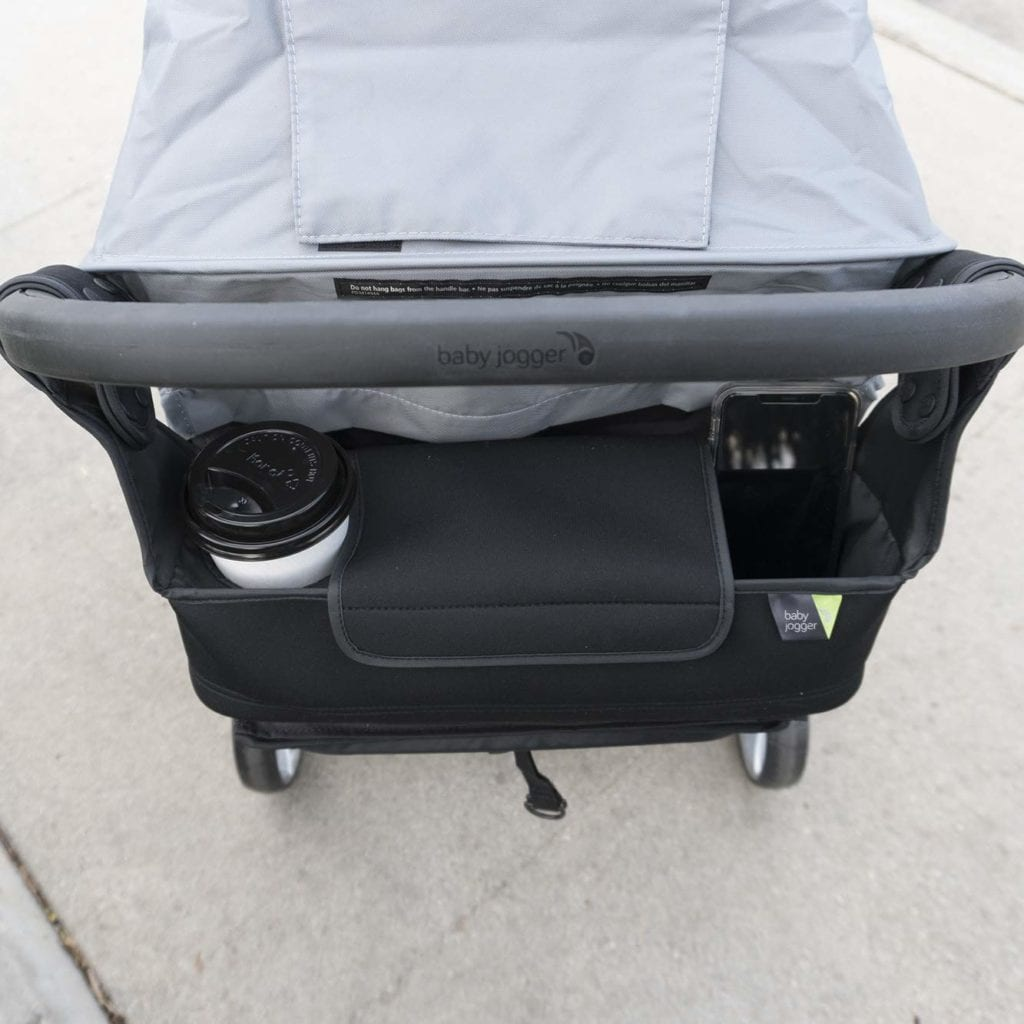 baby jogger parent console with cup and phone