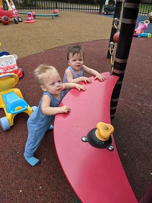 boy/girl twins playing outside