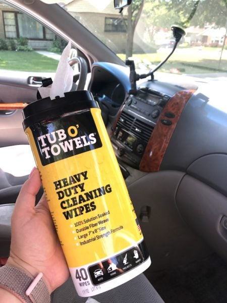 a box of tub o towels wipes and the dashboard of a minivan
