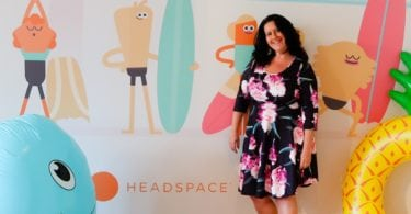 Nat in front of Summer themed Headspace wall