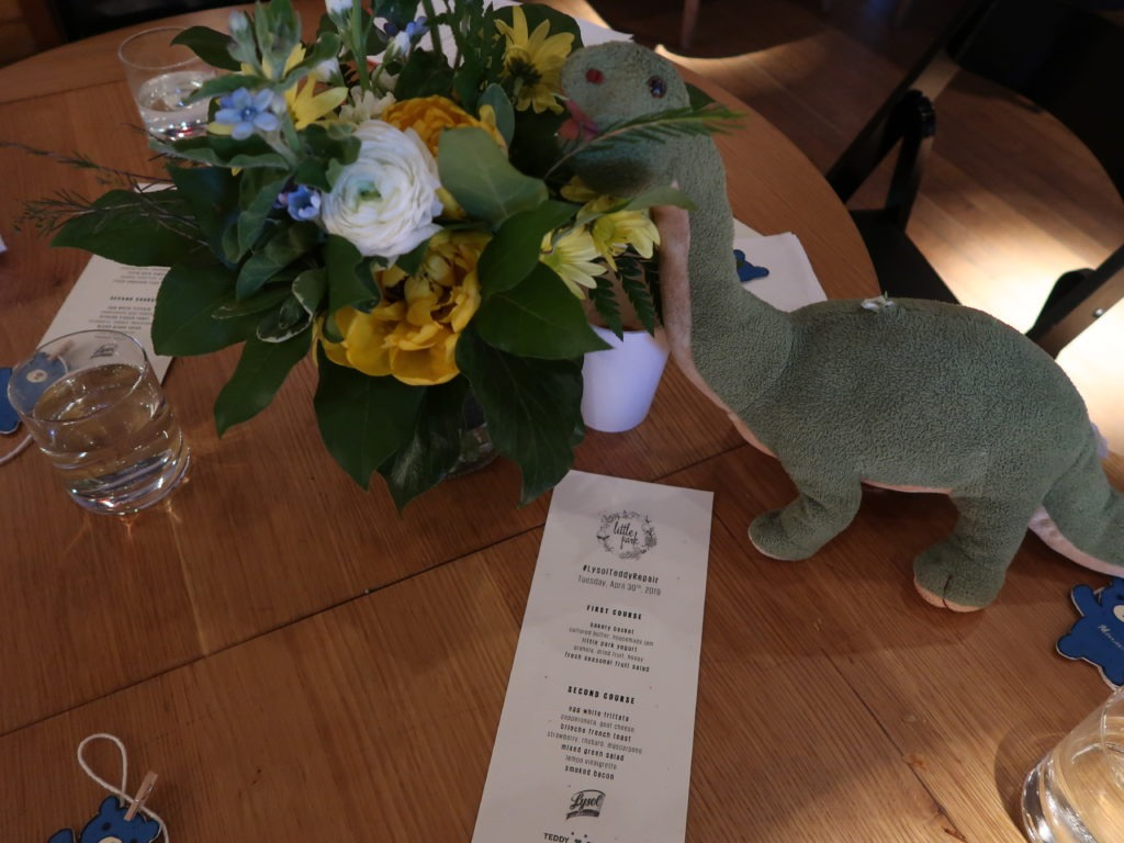 Stuffed Dinosaur eating flowers lysol