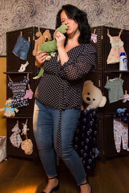 Natalie Diaz and a stuffed Dino
