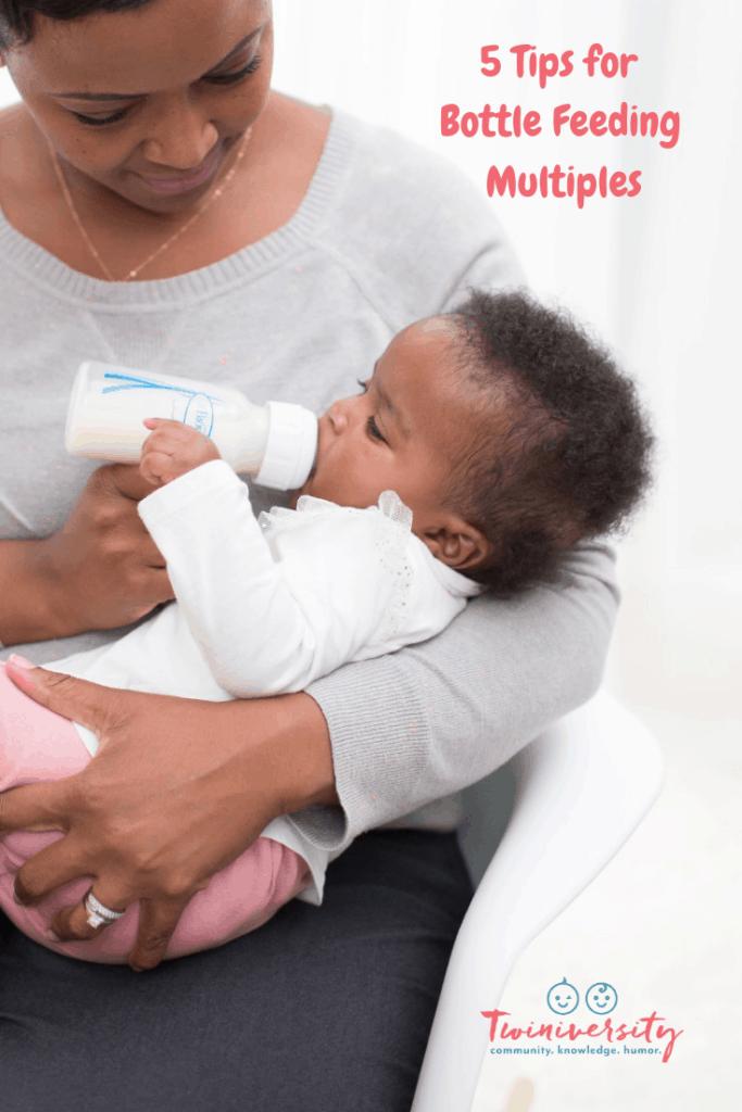 mom feeding baby with bottle feeding multiples