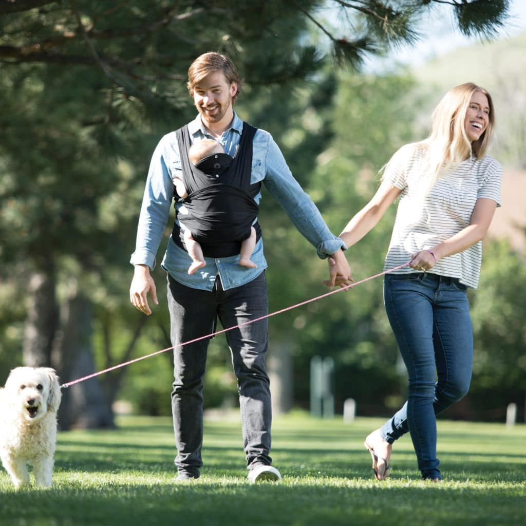 mom and dad in park truth about babywearing