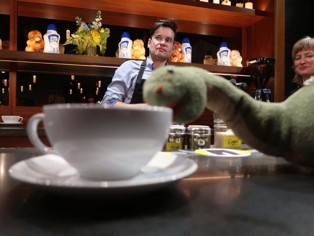 Dinosaur drinking coffee lysol