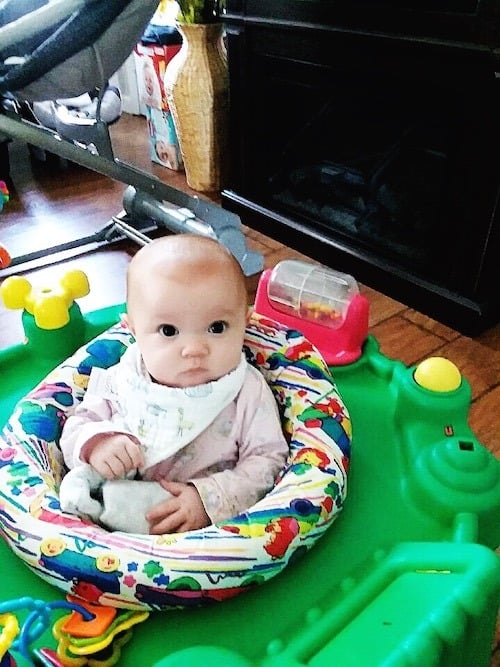 baby sitting in an exersaucer maternity leave